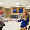 Joed Viera/Staff Photographer-<br /> Denise Giambrone gives Lockport High School cheerleaders Kaylee Platter 15 and Maritina Dimillo 14 a boardgame in lieu of payment to enter the School's Varsity basketball game on Tuesday night, the toys collected by the cheerleaders will be donated local needy children.