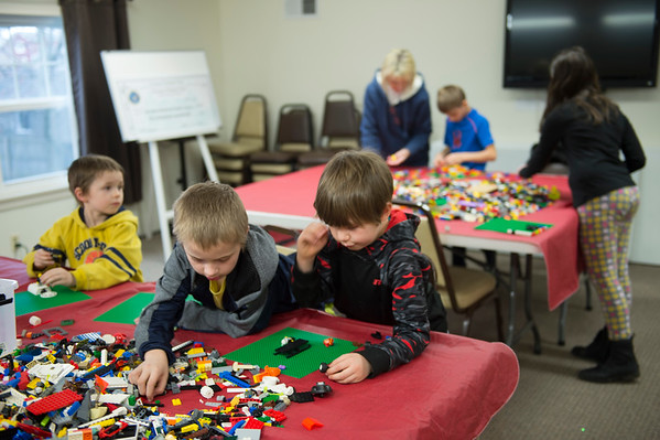 JOED VIERA/STAFF PHOTOGRAPHER-Kids take part in LEGO Club at the Royalton Hartland Community Library Wednesday afternoon.