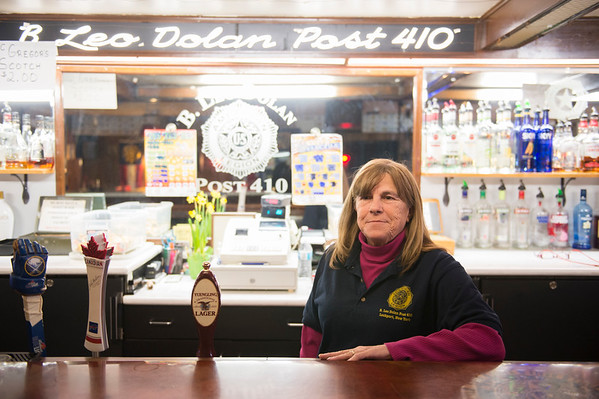 Joed Viera/Staff Photographer-Linda Petersen tends bar at the American Legion Post 410. Earlier this year, the members of Post 410 conceded to the changing demographics of local veterans groups, and put their home of 71 years, at 42 Niagara St., up for sale. Friday is the last day the Post is set to be open.