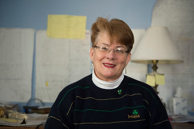 Joed Viera/Staff Photographer Lockport, NY-Shelley Richards sits in her home office.