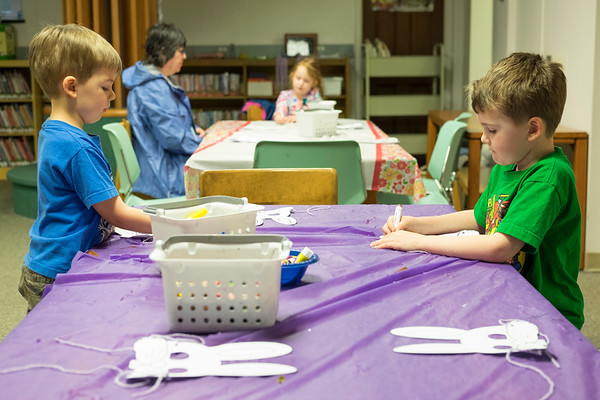 JOED VIERA/STAFF PHOTOGRAPHER-Lockport, NY-Brothers Ryan and Shane Callahan, 4 and 6, make easter bunny masks during craft time at the Lockport Library.