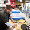 JOED VIERA/STAFF PHOTOGRAPHER-Lockport, NY-Dominos franchise owner Allan Erwin prepares pizza at the recently opened restaurant on Beattie Avenue.