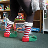 "Joed Viera/Staff Photographer-Joan Barrett, who considers herself one of Santa's elves, hopped off the shelves at Santa's Sleigh to stock the toy store for the underprivileged at St John's Outreach Center. Anyone registered at St. John's Food Pantry is automatically eligible to ""shop"" through the store and pick out donated gifts free of charge. In addition they are provided with free stocking stuffers, wrapping paper and a bow. Starting Monday, anyone who is income eligable is able to sign up to shop at Santa's Sleigh. For more information contact St. John's Outreach at (716) 433-5252"