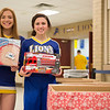 Joed Viera/Staff Photographer-<br /> Lockport High School cheerleaders Kaylee Platter 15 and Maritina Dimillo 14 gather toys in lieu of payment to enter the School's two varsity basketball games on Tuesday night, the toys will be donated local needy children.