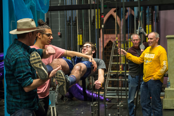 Joed Viera/Staff Photographer Lockport, NY-ZFX flying director Schafer Ramsey and Marc Thagard help Nathan Ribbeck on to the cable system during rehearsals for Lockport High School's production of The Little Mermaid.