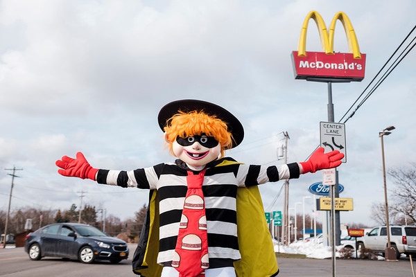 JOED VIERA/STAFF PHOTOGRAPHER-Wrights Corners, NY-The Hamburglar directs people to the McDonalds on Lockport-Olcott Road Tueday evening. 20 Newfane Elementary School teachers worked  the 4-6:30 p.m. shift at the McDonalds for the second annual McTeachers night. The event was a fundraiser with a percentage of sales going towards Newfane Elemantary to help pay for school assemblies and field trips.