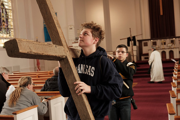 JOED VIERA/STAFF PHOTOGRAPHER-Tony Shay and Cameron Bonnano volunteer to carry the cross from Lockport United Church of Christ to their first stop at First Presbyterian Church during the annual Good Friday Cross Walk. For more photos and information on the journey turn to: