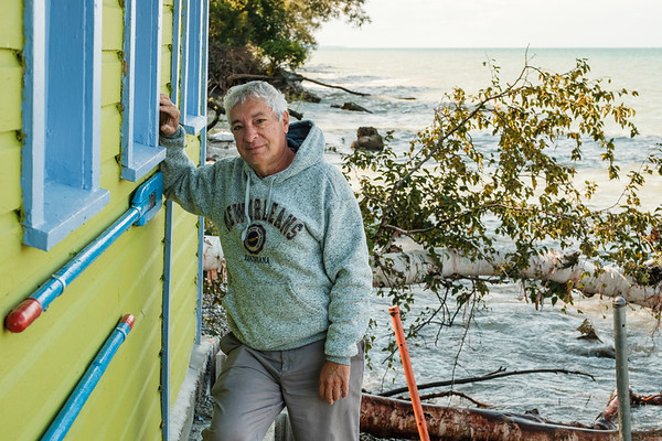 Joed Viera/Staff Photographer-This September 8th, 2017 photo shows Rich Flay standing by his damaged Sunset Island beach house in Wilson, N.Y. Tuesday, the President Trump declared a major disaster for areas in  Niagara, Oswego, Jefferson, St. Lawrence, Orleans, and Wayne Counties (Joed Viera/Lockport Union-Sun & Journal)