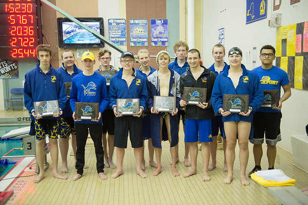 Joed Viera/Staff Photographer-Seniors on Lockport High School's swimming team were given plaques to commemorate their last meet as students.