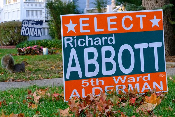 Joed Viera/Staff Photographer-A squirrel stands between signs for 5th ward candidates Michelle Roman and Richard Abott on next door neighbor's lawns on Cleveland Place.