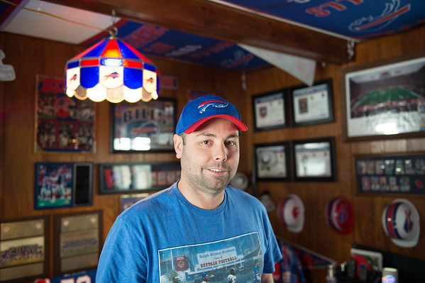 JOED VIERA/STAFF PHOTOGRAPHER-Lockport, NY-Matt Devine in his Bills Room.