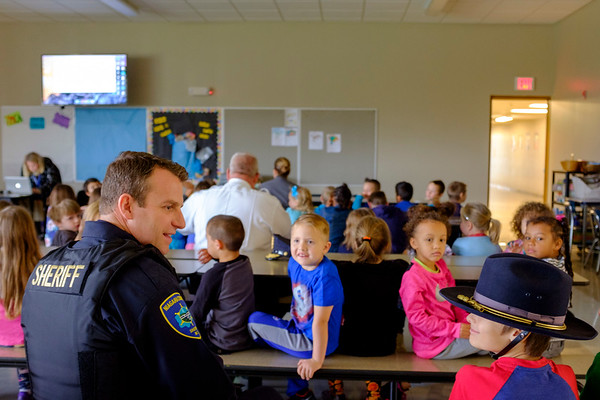 Joed Viera/Staff Photographer- An admiring Caden Edwards, a Roy B Kelly second-grader, wears a Sheriffs hat while looking up at Niagara County Sheriffs Lt. Brian Harrer in the School's Cafeteria. Roy B Kelly Students hosted Harrer and other Niagara County law enforcement officers in attendance with a video they made in celebration of Lockport Blue