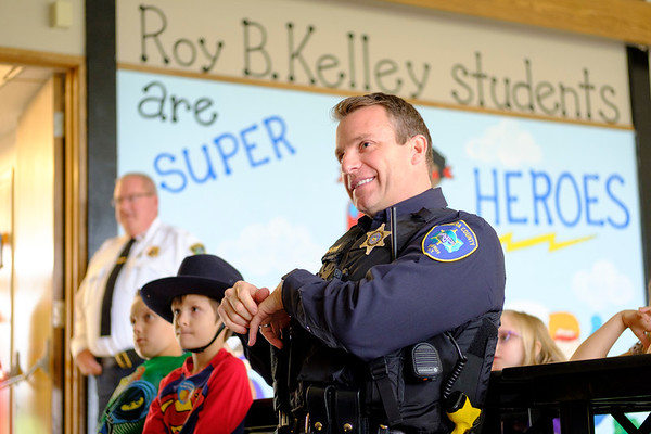 Joed Viera/Staff Photographer-  Niagara County Sheriffs Lt. Brian Harrer and Roy B Kelly students watch a video the school made in celebration of Lockport Blue