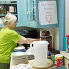 Joed Viera/Staff Photographer-Edna Stubbs works in the Lockport United Church of Christ kitchen.