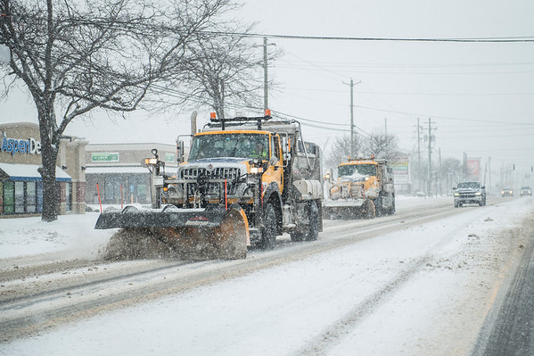 Joed Viera/Staff Photographer-DOT trucks plow Transit Road.