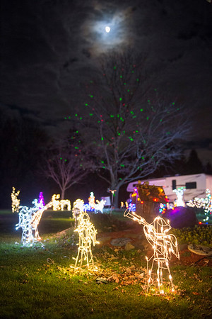 Joed Viera/Staff Photographer-Christmas decorations light up the front yard of this Ridge Road Home in Cambria.