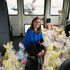 JOED VIERA/STAFF PHOTOGRAPHER-Ridge Road Express Cares Liason Brandi Newman shows off school bus packed full of over a hundred easter baskets they collected to donate to John R. Oishei Childrens Hospital in Buffalo.