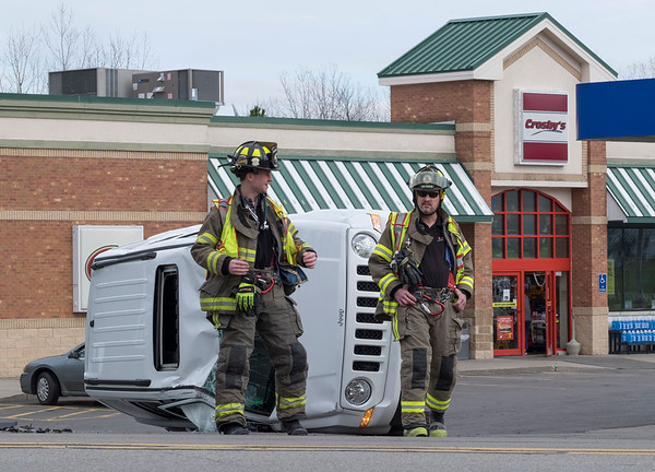 JOED VIERA/STAFF PHOTOGRAPHER-Lockport, NY- Wrights Corners Volunteer firefighters work the scene of a rollover accident at the Crosbys on the corner of Lake and Old Niagara Roads. Lake road was shut down from Old Niagara Road to Slayton Settlement Road.