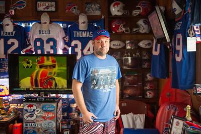 JOED VIERA/STAFF PHOTOGRAPHER-Lockport, NY-Matt Devine in his Bills Room.