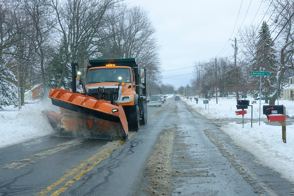 JOED VIERA/STAFF PHOTOGRAPHER-Lockport, NY-A plow cleans up East High Street Friday morning.