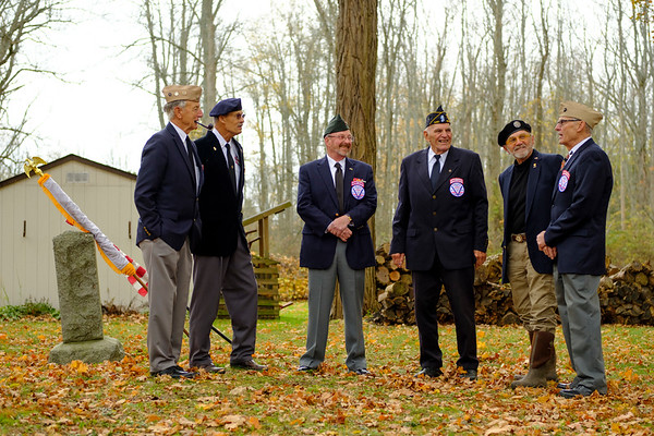 Joed Viera/Staff Photographer-Pendleton Veterans Association Honor Guard members Bill Rott, Tom Burns, Gordy Bellinger, Bob Poth, Tom Ostrowski and Tom Murray by the grave of Sylvester Pendleton Clark.
