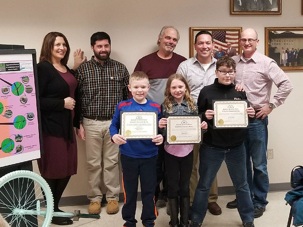 "CONTRIBUTED PHOTO-Pendleton, NY-Pendleton Town Clerk Deborah Maurer with Town Board members Justin Graham, Dave Fischer, Todd Ostrowski and Joel Maerten present Matias Anderson, Mihla Smith and Lawson Smith with the town's first ""Sylvester Pendleton Clark"" Appreciation Awards."