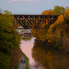Joed Viera/Staff Photographer-A trio walks by golden foliage reflecting on the waters of the Erie Canal.