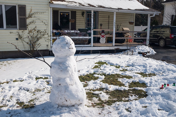 Joed Viera/Staff Photographer-An Olcott snowman stayed frosty despite Thursdays warmer tempuratures.