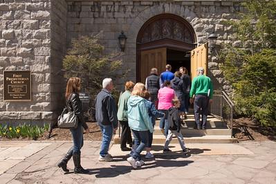 JOED VIERA/STAFF PHOTOGRAPHER-Lockport, NY-Participants follow the cross into First Presbyterian Church on Church Street during the crosswalk.