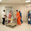 Joed Viera/Staff Photographer-The inmates move their plates from the Kitchen to their programs room  during Chef Bobby Anderson's F-Bites program at Niagara County Jail.