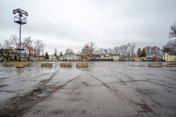 Joed Viera/Staff Photographer-In December the City won  a grant from the state Office of Parks, Recreation and Historic Preservation to convert this South Street parking lot on into a playground. Lift Up Lockport and Mayor Anne McCaffrey are pushing for it to be named after Aaron Mossell.