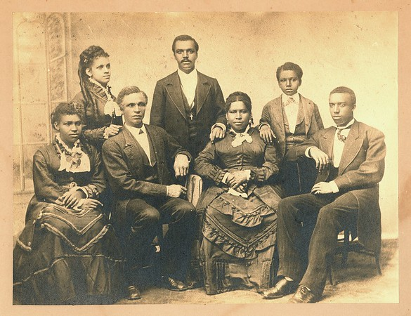 A portrait of the Mossell family. From Left: May Mossell, Alvarilla Mossell, Aaron Albert Mossell I, (sitting) Charles Mossell, Eliza Bowers Mossell, Aaron Albert Mossell II and Nathan Francis Mossell.<br /> <br /> Aaron Mossell helped desegregate Lockport City Schools in 1876.