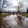 JOED VIERA/STAFF PHOTOGRAPHER-Lockport, NY- Ice and snow melts into Donner Creek on Hamm Road. Weather forecasts call for more snow this evening.