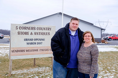 Joed Viera/Staff Photographer- Pendleton, NY- Owners Jacob and Jennifer Wankasky stand outside the soon to be opened 5 Corners Country Store & Antiques. The store's grand opening is on Feburary 25th.