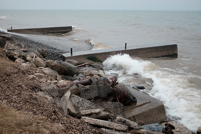 JOED VIERA/STAFF PHOTOGRAPHER-Waves crash onto the Lake Ontario shoreline at Barker Bi-Centennial Park Tuesday afternoon. The Village of Barker is receiving almost $50,000 in state funds to construct a new break-water after the park has lost 18-24 inches of shoreline from erosion exposing tree-roots and pipes.