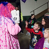 Joed Viera/Staff Photographer-6 year-old John Grucza gives a clown a high five.