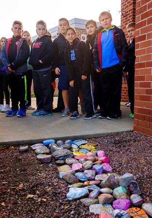 Joed Viera/Staff Photographer-Starpoint Regan Intermediate School students attend a ribbon cutting ceremony for their Kindness Rocks display.