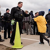 Joed Viera/Staff Photographer- Stairpoint students are congratulated at the Turkey Trot finish line by Niagara County Sheriffs department, Lockport Police and New York State Police.