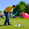 JOED VIERA/STAFF PHOTOGRAPHER-Lockport, NY-Niagara Academy student Noah Stiles, 16. swings towards a pink hungry hippo at the Lions Club's Diverse Students Golf Clinic at Willowbrook Golf Course.