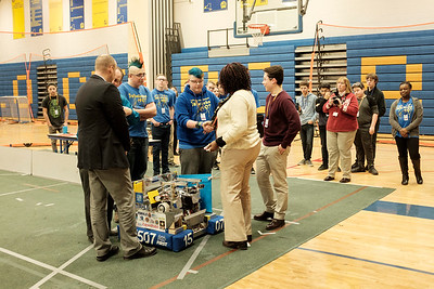Lockport High School's FIRST robotics team the Warlocks show off their robot during a presentation in the school gym on Monday.