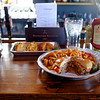 Joed Viera/Staff Photographer-A bacon and cheese stuffed burger and fried macaroni and cheese balls rest on Stooges bar.