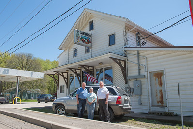 JOED VIERA/STAFF PHOTOGRAPHER-Lyndonville, NY- Brian Spencer, Marilyn Lartz and Bruce Spencer stanf outside the soon to be reopened The Country Store.