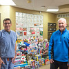 Joed Viera/Staff Photographer- Dr. James Shaw and Dr. Todd Retell in front of gifts at the Lockport Dental Group office. The gifts are for their annual Toys for Smiles program. Saturday a caravan of Mini Coopers will pick up toys from a number of drop off locations and transport them with the help of Santa Clauss to Lockport Youth Services.