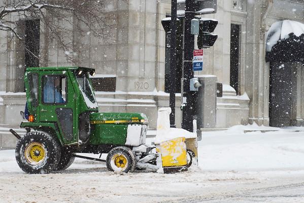 JOED VIERA/STAFF PHOTOGRAPHER-Lockport, NY-A John Deere tractor in between shoveling sidewalks along Pine Street and Main Street.