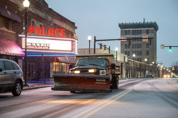 JOED VIERA/STAFF PHOTOGRAPHER-Lockport, NY-A Lockport City snowplow drives down Main Street as snow began to accumulate Fiday evening.