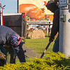 Joed Viera/Staff Photographer-A large billboard featuring a cooked turkey teases Northeast Landscaping crew members Ryan Swenson and John Tall as they install a path to the crosswalk button in front of Tops on Transit Road.