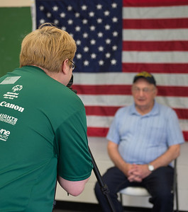 JOED VIERA/STAFF PHOTOGRAPHER-Cambria, NY-Carl Miller interviews and records veteran Frank Gergao for a DVD project to preserve veterans service stories for posterity. Carl performs the interviews at St. Peters Church on 4169 Church Road in Cambria. If you or any of your family members are interested in participating in the recordings you can contact the church office at 716-433-9014.