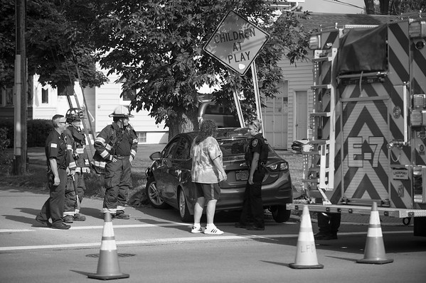 JOED VIERA/STAFF PHOTOGRAPHER- Emergency services arrive at the scene of an accident that occured around 5:30pm Thursday evening where a motor vehicle struck a children at play sign and tree on the corners of South Transit Street and Price Street