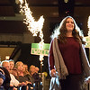 Joed Viera/Staff Photographer- Emma Anderson, 15, walks the runway at the annual DECA Club fashion show at the Lockport High School Auditorium Friday night. The 50 member club put on the show with a goal of raising $2,500 to use on expenses for different competitions.