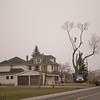 JOED VIERA/STAFF PHOTOGRAPHER-Workers  cut limbs off of trees in front of a Townliine Road home.